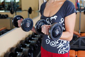 Woman with dumbbell — Stock Photo