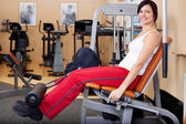 Young attractive brunette woman in the gym — Stock Photo
