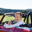 Happy man driving a cabriolet — Stock Photo