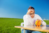 Dejected man looking at his piggy bank — Stock Photo