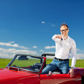 Man in convertible — Stock Photo