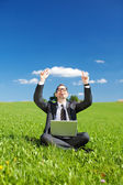 Successful man working outdoors in a green field — Stock Photo