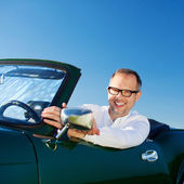 Happy man driving a cabriolet — 图库照片