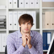 Thinking serious Businessman In Office — Stock Photo #26052209