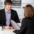 Stock Photo: Candidate Looking At BusinesswomTaking Interview