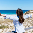 Woman With Arms Outstretched At Beach — Stok fotoğraf