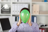 Businessman Holding Balloon In Front Of Face — Stock Photo
