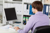 Young Businessman At Desk — Stock Photo