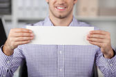 Young Businessman Holding A White Paper — Stock Photo