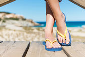 Woman Wearing Flip-Flops While Standing On Board Walk — Stock Photo