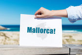 Womans Hand Holding Mallorca Sign At Beach — Stock Photo