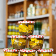 Jars of white cheese cubes and herbs in a grocery — Stock Photo