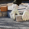 Construction worker with pavestone — Stock Photo