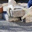 Stock Photo: Construction worker paving brick road