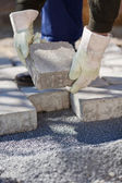 Bricklayer paving a street — Stock Photo