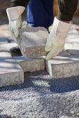 Bricklayer paving a street — Stock Photo