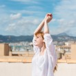 Young woman on a rooftop terrace — Stock Photo #26088291