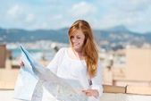 Woman with a route map — Stock Photo