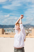 Young woman on a rooftop terrace — Stock Photo