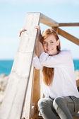 Woman enjoying the coastal sunshine — Stock Photo