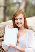 Woman displaying a blank tablet screen — Stock Photo