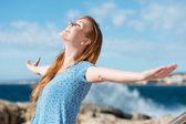 Beautiful woman celebrating the sunshine — Stock Photo