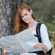 Woman backpacker with a map — Stock Photo #26092167