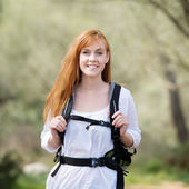 Young woman out hiking with a rucksack — Stock Photo