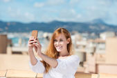 Smiling woman taking her photograph — Stock Photo