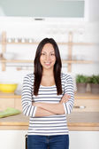 Self-confident young woman standing in the kitchen — Stock Photo