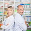 Pharmacists standing back to back — Stock Photo