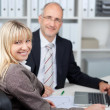 Stock Photo: BusinesswomSitting With Male Coworker at work
