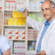 Pharmacist talking to female client — Stock Photo