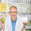 Pharmacist with apple and box — Stock Photo #26134469