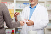 Client paying 10 euro in pharmacy — Stock Photo