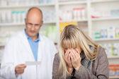 Customer Sneezing With Pharmacist Reading Prescription Paper — Stock Photo