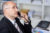 Serious manager at the phone — Stock Photo
