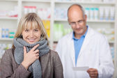 Smiling client with scarf in pharmacy — Stock Photo