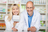Two phamacists presenting medicin box — Stock Photo