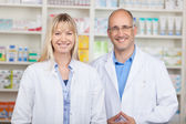 Confident Male And Female Pharmacists Standing In Pharmacy — Stock Photo