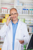 Confident pharmacist calling — Stock Photo
