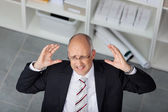 Frustrated Mature Businessman Raising Arms In Office — Stock Photo