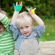 Two little boys showing their colored hands — Stock Photo