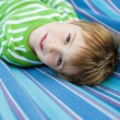 Cute little child lying in the hammock — Stock Photo