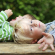 Two boys relaxing in the garden — Stock Photo