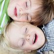 Stock Photo: Smiling Little brothers lying close together