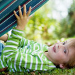 Cute little boy playing with hammock — Stock Photo