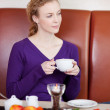 Woman Holding Coffee Cup While Looking Away — Stock Photo