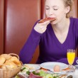Woman enjoying breakfast in hotel — Stock Photo