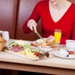 Woman having breakfast in hotel — Stock Photo